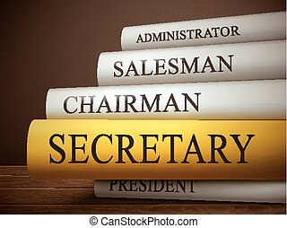 book title of secretary isolated on a wooden table over dark...