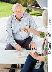 Senior Couple Playing Dominoes