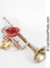 Red wine in a glass and old trumpet