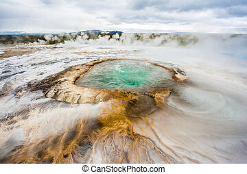 Hveravellir - Pool with boiling geothermal water at...