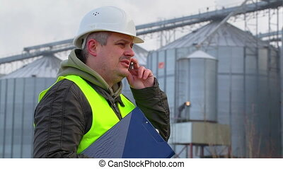 Worker with folder and cell phone
