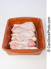 Raw chicken little legs - Chicken thighs or legs on rustic...