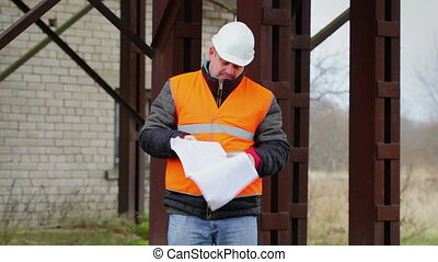 Worker with documents at outdoors in factory