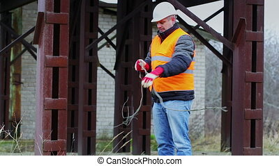 Worker with wire in factory