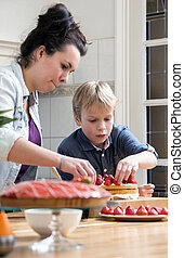Mother And Son Preparing Cake In Kitchen - Au Pair and son...
