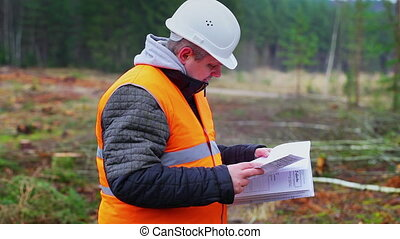 Forest engineer destroying sensitive documents in the forest...