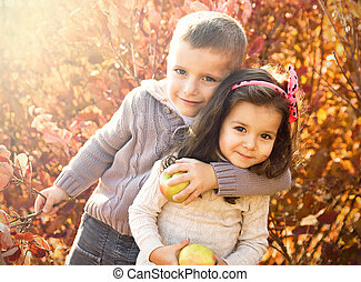 children - boy embraces girl happy face on a background of...