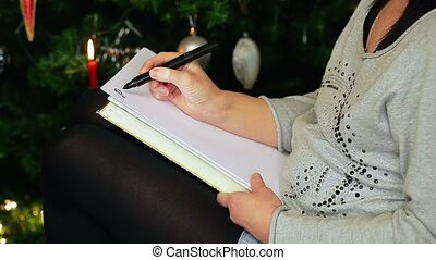 Nervous woman streaking paper with black stripes