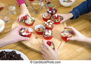 Kids Picking Cupcakes At Table - Kids picking their...
