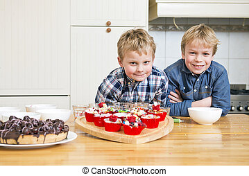 Brothers in a kitchen - Two brothers posing in a kitchen,...