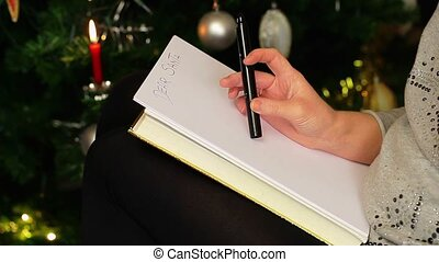 Women start to write letter to Santa