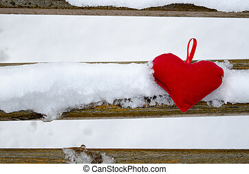 Heart on a snow covered bench
