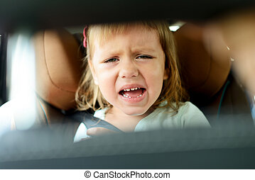 tears in car - toddler girl crying in car