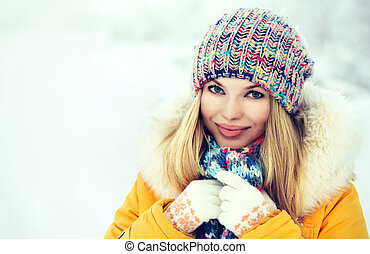 Winter Woman Face happy smiling in knitting hat fashion...