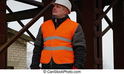 Foreman with documents in factory