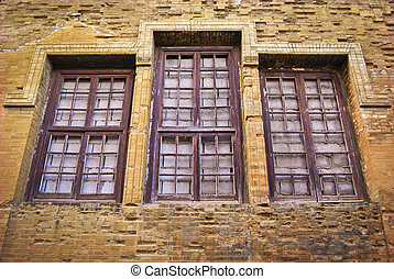 Boarded windows - Orange brick wall boarded windows