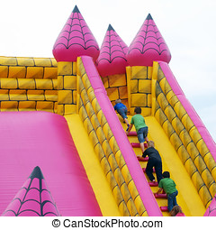 Bumper castle - Children climb steps in inflatable bumper...