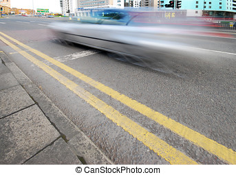 Fast lane - Speeding car travelling on city ring road