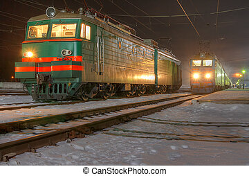 train - Old intercity train stops at a station in the winter...