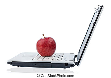 apple lying on a keyboard - an apple is on the keyboard of a...