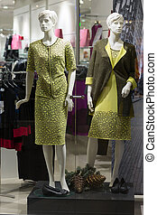 Showcase womens clothing store, plastic mannequins
