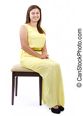 Teenager girl sitting on chair on white background