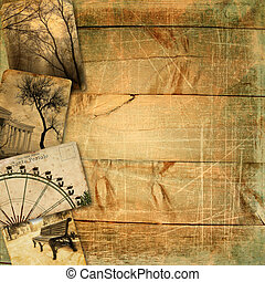 Old postcards on wooden planks with scratches and texture -...