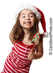Christmas girl with cheeky smile - Little Christmas girl...