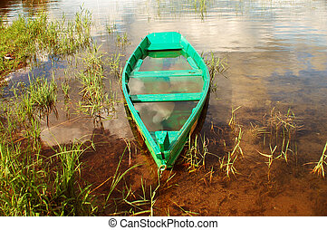 The sunk boat. - Beautiful view with a boat submerged in...