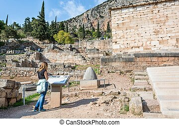 Visitor reading a description of an ancient ruin - Visitor...