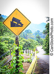 warning steep road sign slope and truck on hill.