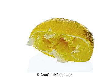 squeezed lemon - a squeezed lemon on a white background...