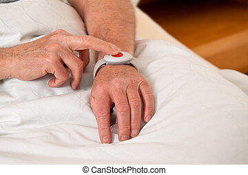 senior with rufhilfe emergency phone in bed