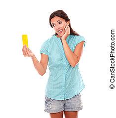 Charming hispanic woman taking photos of herself or selfie...