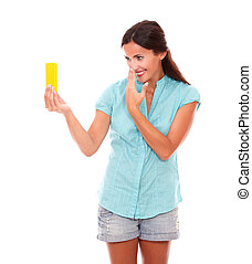 Charming young woman taking photos of herself or selfie...