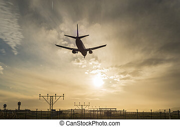 Airplane landing at dusk. - Silhouette of an airplane...