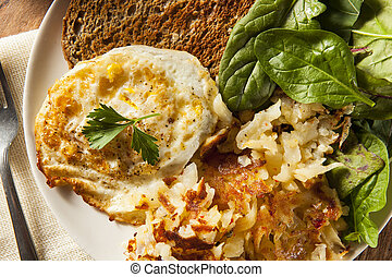 Organic Homemade Fried Eggs with Toast and Hashbrowns
