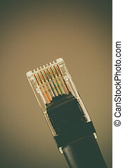 Ethernet cable - Vintage style macro shot of a CAT 5...