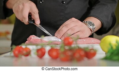 Cutting meat - Slicing the meat with a sharp knife on a...
