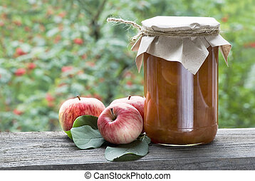 grandma's recipe - apple confiture and three fresh apples in...