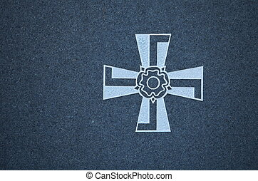 Finnish swastika Cross - Finnish Military Cross on granite