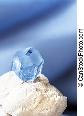 gemstone aquamarine - aquamarine gemstone in an albite on a...