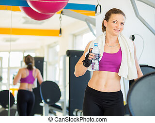 Fitness - Young woman training in Gym