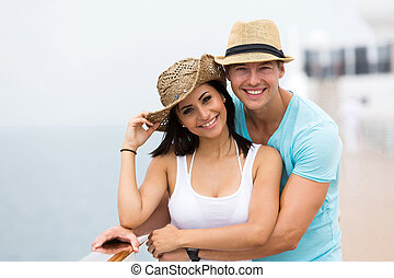 couple enjoying a cruise vacation - adorable couple enjoying...