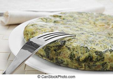 tortilla de espinacas, spanish spinach omelette - closeup of...