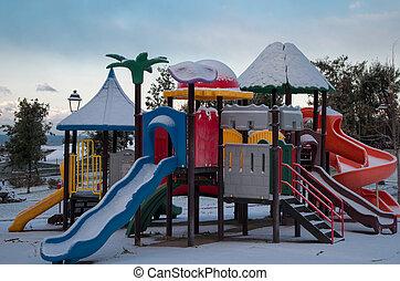 Snowed carousel in park in Torre del Greco