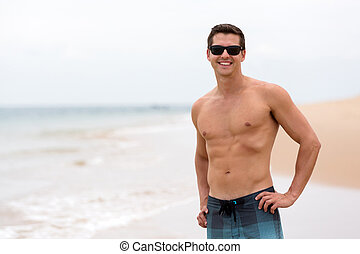 young man at the beach - attractive young man at the beach