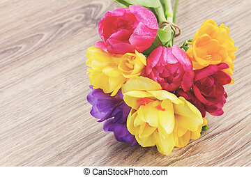 posy of spring flowers on wooden table - posy of pink...