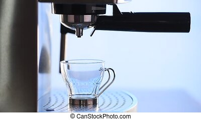Espresso - Modern glass cup of black coffee brewing via a...