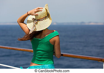 rear view of young woman wearing summer hat